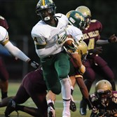 Seton-La Salle's Danzel McKinley-Lewis, #4, breaks through the Steel Valley defensive line during a game in September.