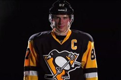 Sidney Crosby models the Penguins' new third jersey, which is nearly identical to the road black jersey the team wore during its Stanley Cup-winning seasons of 1990-91 and 1991-92.