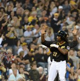 Andrew McCutchen signals to the Pirates dugout after hitting a triple Friday night against the Brewers at PNC Park.