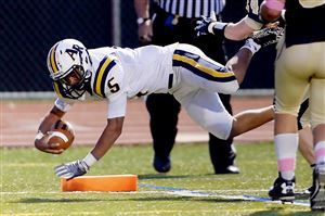 Apollo-Ridge's Duane Brown dives into the end zone for a touchdown against Shady Side Academy.