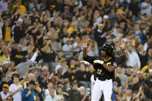 Andrew McCutchen signals to the Pirates dugout after his triple Friday against the Brewers at PNC Park.