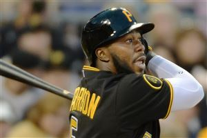 Peter Diana/Post-Gazette Josh Harrison of the Pirates singles against the Brewers Friday at PNC Park