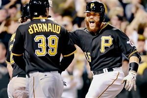 Russell Martin celebrates with Chase d'Arnaud after Martin's eighth-inning home run put the Pirates ahead 3-2 against the Brewers at PNC Park.