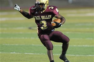 Steel Valley's DeWayne Murray runs the ball in the first half of the game against Seton-La Salle at home in Munhall.