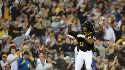 Pittsburgh Pirates centerfielder Andrew McCutchen signals to the Pirates dugout after hitting a triple Friday night against the Brewers at PNC Park.