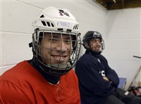 Dan McCoy, 20, left, who has spina bifida, gets ready to work out with his local team, the Mighty Penguins, which includes Nick Booth,16, from Johnstown. McCoy is an University of Pittsburgh student from Fox Chapel who was on the Paralympic gold medal Ice Sledge Hockey team in Sochi. Practice is at Bladerunners Ice Complex