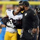 Steelers head coach Mike Tomlin kisses cornerback Ike Taylor's head after he left Sunday's game against the Panthers with a right arm injury.