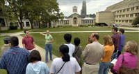 Carnegie Mellon University senior Chrissy O'Leary and engineering major Adam Stoler lead prospective students and their parents on a tour of the CMU campus last summer.