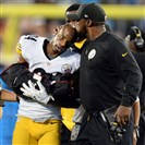 Steelers head coach Mike Tomlin kisses Ike Taylor's head as he's taken off the field with a right arm injury.