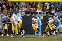 Steelers running back Le'Veon Bell finds a hole Sunday night against the Panthers.