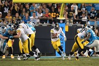 Le'Veon Bell runs thru a huge hole against the Panthers last month at Bank of America Stadium in Charlotte, North Carolina.
