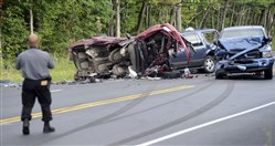 State police investigate the scene of a fatal crash on Route 115 in Effort, Monroe County Saturday in which four children were killed.