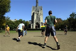 A flag football game takes place Sunday afternoon on the lawn of the Cathedral of Learning on the University of Pittsburgh campus in 2011.