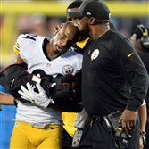 Steelers coach Mike Tomlin kisses Ike Taylor's head as he is taken off the field with a right arm injury against the Panthers in the third quarter at Bank of America Stadium Sept. 21 in Charlotte, N.C. Taylor is expected to start today at Heinz Field against the New Orleans Saints.