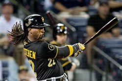 Andrew McCutchen follows through on his sixth-inning home run Monday night in the Pirates' 1-0 win against the Braves in Atlanta.