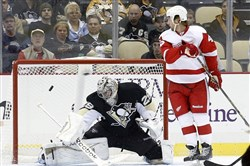 Detroit Red Wings center Darren Helm looks on as a shot by left wing Tomas Tatar eludes Pittsburgh Penguins goalie Marc-Andre Fleury for a goal during the first period at the CONSOL Energy Center Monday night.