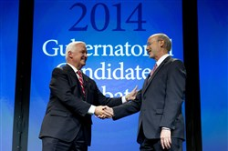 Gov. Tom Corbett, left, and Democrat Tom Wolf shake hands at the end of a gubernatorial debate hosted by the Pennsylvania Chamber of Business and Industry, Sept. 22, 2014, in Hershey, Pa.