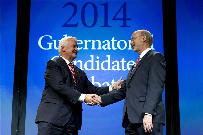 Pennsylvania Gov. Tom Corbett, left, and Democratic challenger Tom Wolf shake hands at the end of a gubernatorial debate hosted by the Pennsylvania Chamber of Business and Industry in September in Hershey, Pa.