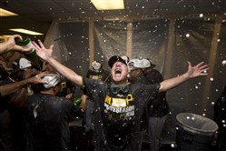 Pirates first base coach Rick Sofield celebrates in the locker room after the Pirates defeated the Atlanta Braves 3-2.