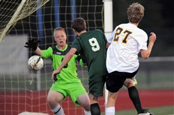 Deer Lakes goalie Austin Barneycastle, left, and defender Chad Zubik, center, can't stop Mars' Andrew Deifenbacher from scoring Tuesday in Mars' 4-1 Class AA Section 2 win.
