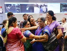 Staff from the Indian Space Research Organization celebrate at the ISRO Telemetry, Tracking and Command Network in Bangalore on Wednesday after the Mission Orbiter Mars spacecraft, or MOM, successfully entered the Mars orbit.