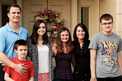 "The Lund family, from left, Don, Brian (in front), Nikki, Catie, Donna and Donny, is the focus of the documentary, ""The Family Next Door,"" which explores the challenges, grace and determination of living with Brian's and Donny's autism."