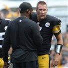 Steelers head coach Mike Tomlin talks with quarterback Ben Roethlisberger as they take on the Buccaneers late in the fourth quarter at Heinz Field on Sunday afternoon.