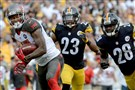 The Buccaneers' Louis Murphy carries as he's defended by Steelers' Mike Mitchell and Cortez Allen in the fourth quarter at Heinz Field Sunday afternoon.