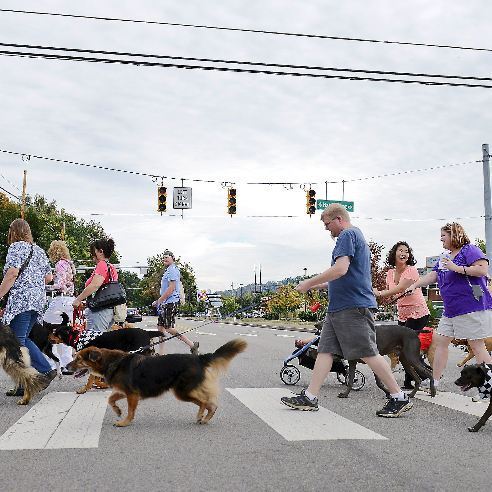About 60 people participated in Walk & Wine Sept. 28 in Sewickley. The event was a walk for people and their dogs that ended at Sewickley Cafe for a glass of wine.