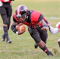 Aliquippa's DiMantae Bronaugh, left, drags a New Brighton defender during a game last September.