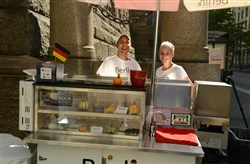 Dustin and Sandra Friedel with their food cart, Berlin Street Food.  The cart is located at the corner of Forbes Avenue and Grant Street, Downtown, during lunch hours.