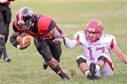 Aliquippa's DiMantae Bronaugh, left, rushed for 1,262 yards and 24 touchdowns last season.