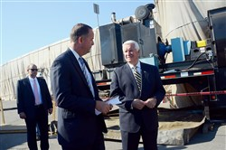 "Former Transportation Secretary Barry Schoch, shown at left with then-Gov. Tom Corbett in September 2014, said he didn't help steer grants to the railroad. ""It was purely based on a scoring system, an evaluation of the system."""