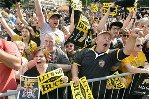 The crowd in Market Square warms up for Wednesday's playoff game at a Pirates rally.