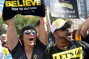 Tammy Sestric, left, and Craig Morris. both from Marshall, chant along with the crowd in Market Square during a rally to support the Pirates.