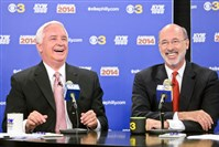 "Pennsylvania Gov. Tom Corbett, left, and Democratic challenger Tom Wolf share a laugh during their debate at ""Breakfast with the Candidates"" event at today in Philadelphia."