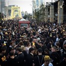 Pirates fans pack Federal Street before tonight's Wild Card game.