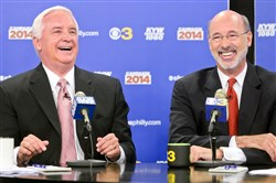 "Pennsylvania Gov. Tom Corbett, left, and Democratic challenger Tom Wolf share a laugh during their debate at ""Breakfast with the Candidates"" event Oct. 1 in Philadelphia."