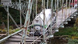 A tanker truck was hauling water to a natural gas drilling site owned by EQT when it broke through the historic Pollocks Mill Bridge in Greene County in September.