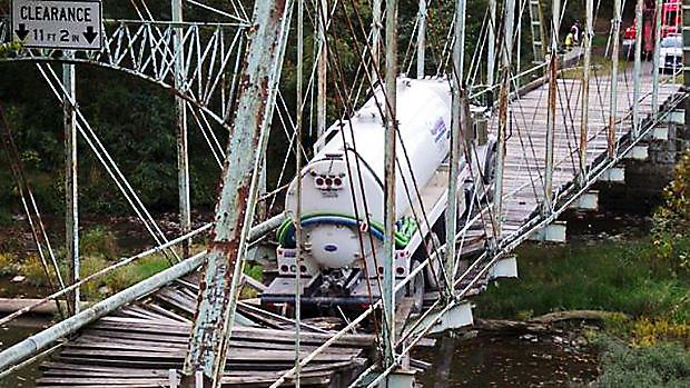 greenecobridge A tanker truck was hauling water to a natural gas drilling site owned by EQT when it broke through the historic Pollocks Mill Bridge in Greene County in September.