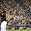 Pirates starting pitcher Edinson Volquez reacts after walking the Giants' Brandon Belt in the second inning against San Francisco  at PNC Park.