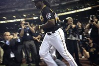 Andrew McCutchen takes the field.