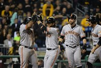 Giants' Brandon Crawford celebrates his grand slam with teammates in the fourth inning of the National League Wild Card Game at PNC Park.