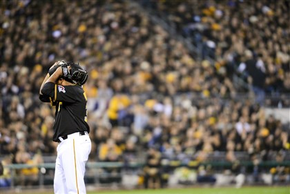 Pirates starting pitcher Edinson Volquez reacts after walking the Giants' Brandon Belt in the second inning Wednesday night against San Francisco at PNC Park.