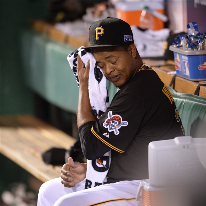 20141001mfPirates19 Pirates' starting pitcher Edinson Volquez reacts in the dugout after being pulled out of the 2014 National League Wild Card game.