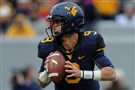 WVU quarterback Clint Trickett led the nation's No. 9 passing attack this season. Offensive coordinator Shannon Dawson is leaving the Mountaineers for the same post at Kentucky.
