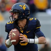 Thirteen of West Virginia's 19 seniors, including quarterback Clint Trickett, transferred to the Mountaineers.