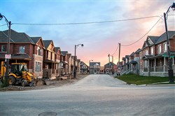 A typical housing development in Markham has homes packed close together with small lawns, because land is at such a premium
