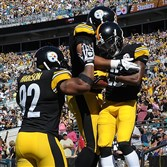 Steelers cornerback Brice McCain (right) celebrates his interception return for a touchdown Sunday at Jacksonville.