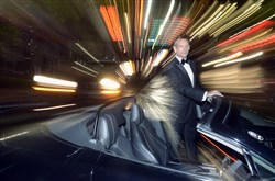 James Taggart as James Bond with an Aston Martin.
